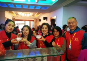 Mr. Gu and Mrs Liu (far left and right) with fellow volunteers